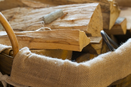 fire place: Wooden pieces for a fire place in a woven basket. Background