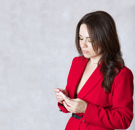 observes: A young lady dressed in a formal way observes the results of a pregnancy test. Stock Photo