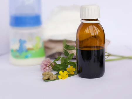 Homeopathic syrup in a glass bottle