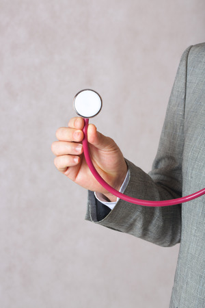 hand free: A man in a classical costumes keeps a stethoscope in his hand. Free space for a text. Stock Photo