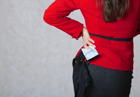 guipure: A euro banknote and a black guipure lingerie in the hand of a young woman.