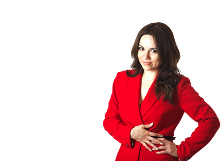 between 30 and 40 years: A young woman between 30 and 40 years old in a classical red jacket on a white background. Stock Photo