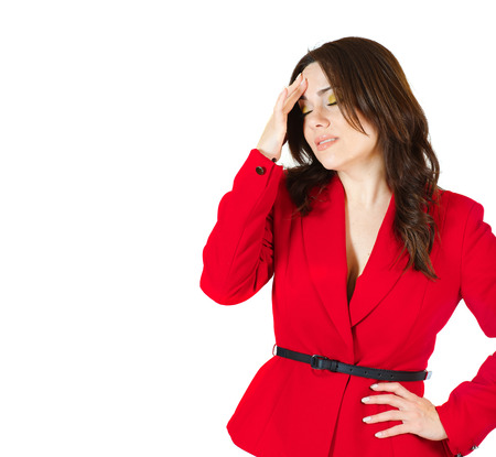 premenstrual syndrome: A young woman between 30 and 40 years old dressed in a classical red jacket with a headache. Isolated over white.Free space for a text Stock Photo