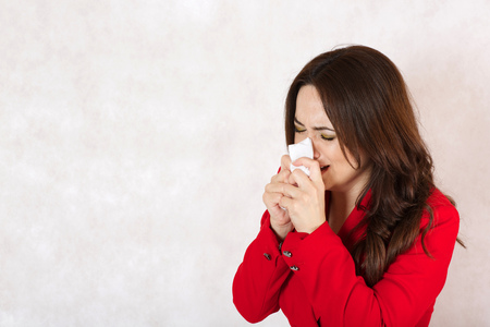 A young woman between 30 and 40 years old is tearing in the handkerchief