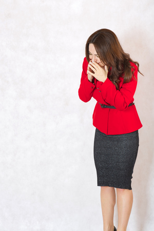 40 years old: A young woman between 30 and 40 years old sneezes Stock Photo