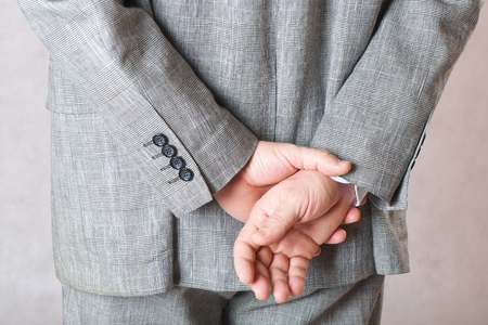 50 to 60 years: Mans hands behind the back. Stock Photo