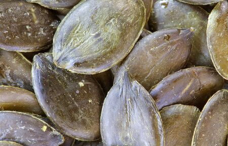 cystitis: Dried green pumpkin seeds. Background Stock Photo