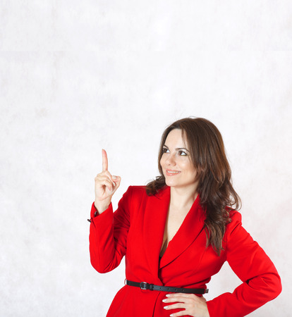 between 30 and 40 years: A young woman between 30 and 40 years old dressed in a classical red jacket got an idea