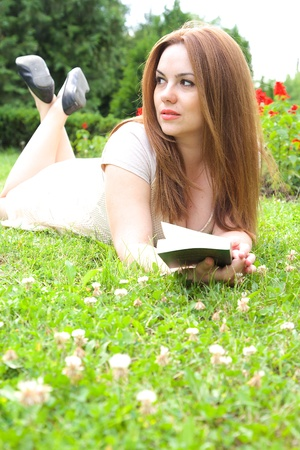 thirties: A young attractive woman in her thirties is keeping a read book.