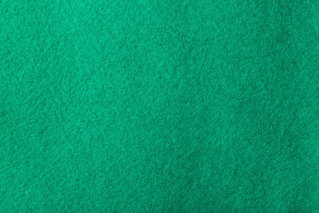 dark green: Dark green coloured felt - background. Stock Photo