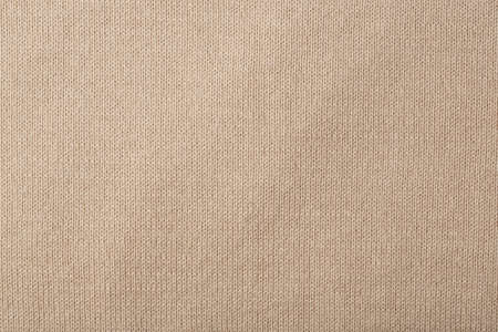 breathable: Beige coloured cotton cloth- background.