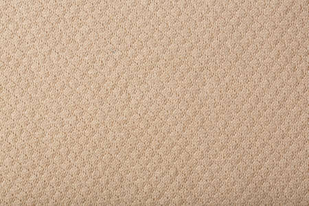 breathable: Beige coloured cotton - background.