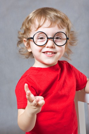 Three years old child is showing three fingers