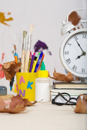 pedagogical: Back to school stationery is on the table. Chalkboard background Stock Photo