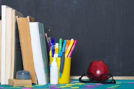 pedagogy: Back to school stationery is on the table. Chalkboard background Stock Photo