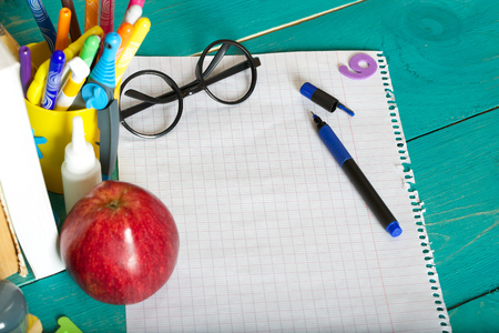 Back to school stationery is on the table. Chalkboard background Stock Photo