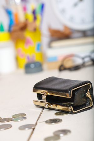 pedagogical: Expenses for preparation to school. Small leather wallet with coins Stock Photo