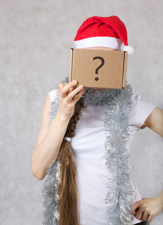 30 year old: Young lady in a Santas hat. Free space for a text.
