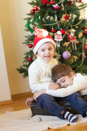 Children close to the Christmas tree Stock Photo