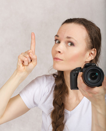 between 30 and 40 years: Young lady between 30 and 40 years old with a camera. Stock Photo