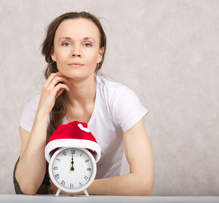 between 30 and 40 years: Young lady between 30 and 40 years in Santa Claus hat