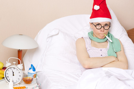 Sick young lady in her bed during new years day celebration