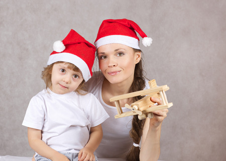 Mother and a son in Santas hats