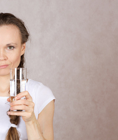 between 30 and 40 years: Young lady between 30 and 40 years has a glass of water