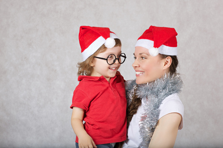 Mother and her three years old son are smiling. Christmas mood