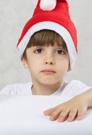 Boy of six years old dressed in Santa Claus