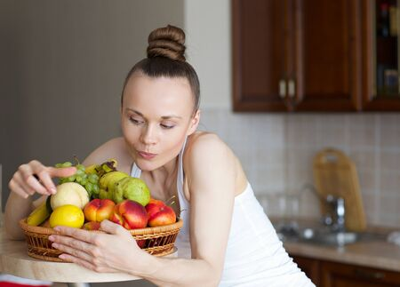 Young slim lady and fruits