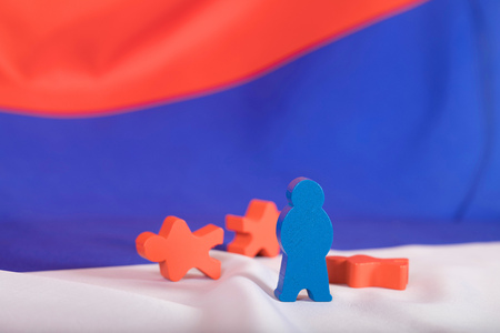 Wooden figures on Russian flag. Closeup