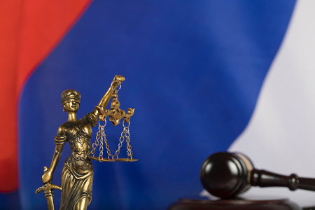Statue of Themis on a flag of Russian Federation. Closeup