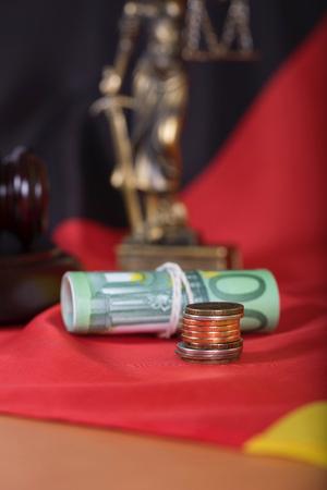 Money on a German flag. Closeup