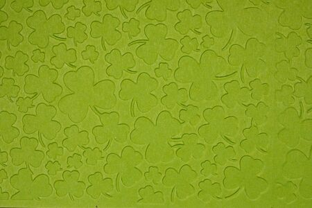 Embossed light green carton paper. Background of shamrock. Extreme closeup