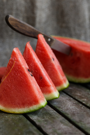 Slices of watermelon on wooden surface. Closeup
