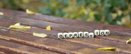 Word DEPRESSION composed of wooden letters. Closeup
