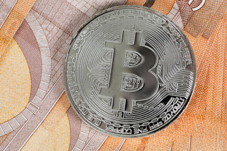 Bitcoin on banknotes of 50 euros. Closeup Stock Photo