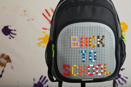School backpack with BACK TO SCHOOL composition. Closeup Stock Photo