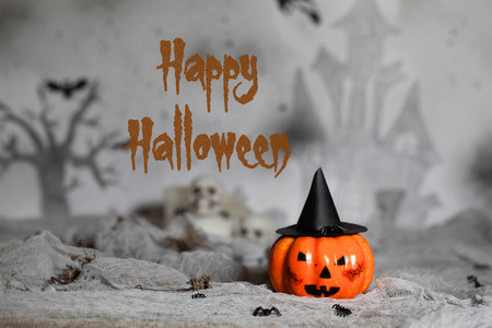 Orange scary pumpkin with witch hat. Halloween background. Closeup Фото со стока