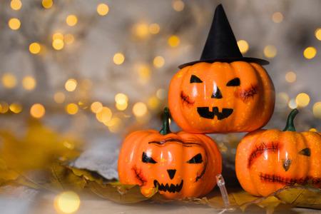 Three spooky orange pumpkins. Nice bokeh in the background. Фото со стока