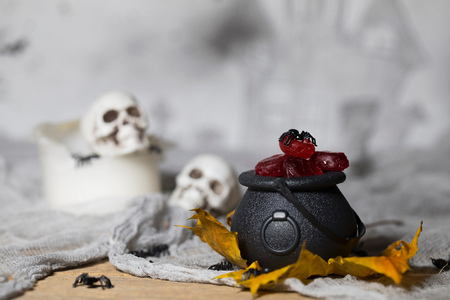 Trick or treat! Candles in the pots for Halloween. Handmade witch in the background