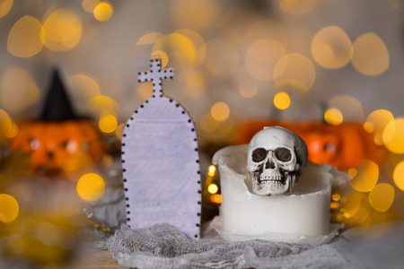 Skull on an used old candle. Spooky halloween background