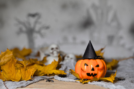 Orange scary pumpkin with witch hat. Halloween background. Closeup