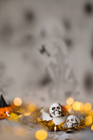 Skull on an old used thick candle. Scary Halloween background. Closeup