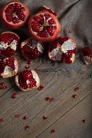 Pomegranate on a wooden surface. Flat lay