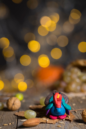 Handmade turkey on Thanksgiving background with blurred night lights. Closeup Stock Photo