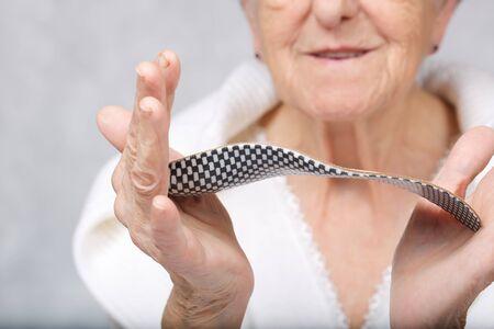 Old woman keeps orthopaedic sole insert