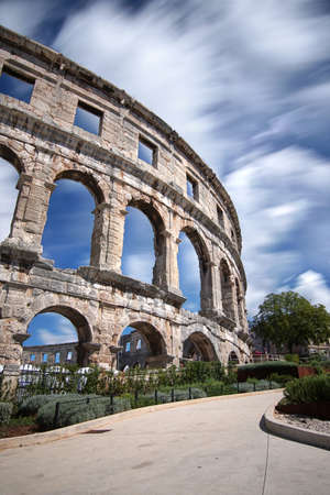 View Of Old Ruin Building of Amphitheater in Pula Against Sky Without People