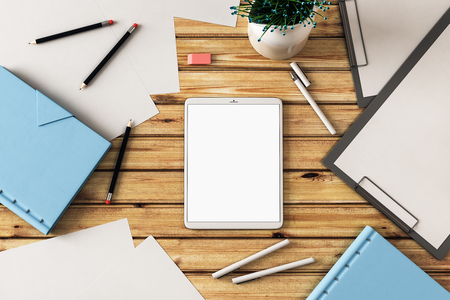 blank white tablet screen with paper, pens and notebook on wooden table. 3D render